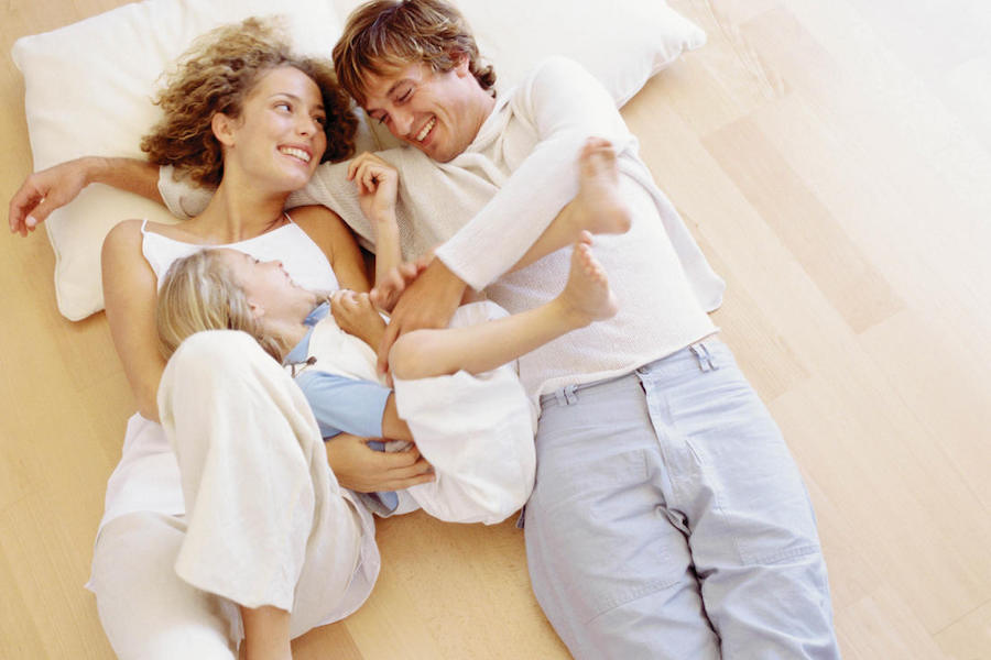 Couple & Child On Floor